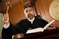 Middle-aged judge forming sentence Stock Photo - Premium Royalty-Freenull, Code: 693-06021028