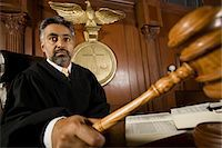 Middle-aged judge forming sentence Stock Photo - Premium Royalty-Freenull, Code: 693-06021029