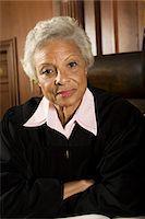 Female judge sitting in court, portrait Stock Photo - Premium Royalty-Freenull, Code: 693-06021035