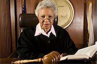 Female judge sitting in court, portrait Stock Photo - Premium Royalty-Freenull, Code: 693-06021036