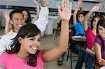 High School Students Raising Their Hands in Class Stock Photo - Premium Royalty-Free, Artist: Blend Images, Code: 693-06021056