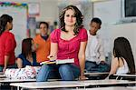 High School Student Sitting on a Desk Stock Photo - Premium Royalty-Free, Artist: Blend Images, Code: 693-06021066