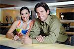 Couple Drinking Martinis Stock Photo - Premium Royalty-Free, Artist: Blend Images, Code: 693-06021218