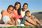 Family sitting on grass Stock Photo - Premium Royalty-Free, Artist: Kevin Dodge, Code: 693-06021449