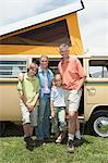 Family of four stand at campervan Stock Photo - Premium Royalty-Free, Artist: Siephoto, Code: 693-06021506