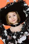Portrait of girl (7-9) wearing witch costume for Halloween Stock Photo - Premium Royalty-Free, Artist: Aflo Relax, Code: 693-06021607
