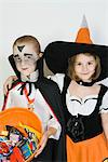Portrait of girl embracing boy (7-9), wearing Halloween costumes Stock Photo - Premium Royalty-Free, Artist: Blend Images, Code: 693-06021611