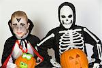 Portrait of boys (7-9) wearing Halloween costumes Stock Photo - Premium Royalty-Free, Artist: Ikon Images, Code: 693-06021627