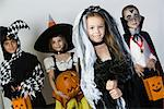 Portrait of boys and girls (7-9) wearing Halloween costumes Stock Photo - Premium Royalty-Free, Artist: F1Online, Code: 693-06021631