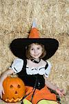 Portrait of girl (7-9) wearing witch costume by hay Stock Photo - Premium Royalty-Free, Artist: Cultura RM, Code: 693-06021632
