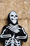 Portrait of child (7-9) wearing skeleton costume by hay Stock Photo - Premium Royalty-Free, Artist: CulturaRM, Code: 693-06021633