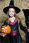 Portrait of girl (7-9) wearing witch costume by hay Stock Photo - Premium Royalty-Free, Artist: GreatStock, Code: 693-06021635