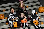 Portrait of boys and girls (7-9) wearing Halloween costumes on steps Stock Photo - Premium Royalty-Free, Artist: GreatStock, Code: 693-06021638