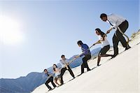 Business People Playing Tug of war in the Desert Stock Photo - Premium Royalty-Freenull, Code: 693-06021766