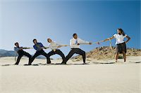 Business People Playing Tug of war in the Desert Stock Photo - Premium Royalty-Freenull, Code: 693-06021783