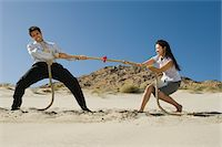 Two Business People Playing Tug of war in the Desert Stock Photo - Premium Royalty-Freenull, Code: 693-06021784