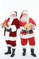 fat man full body - Two men dressed as Santa Claus holding gifts Stock Photo - Premium Royalty-Freenull, Code: 693-06021801