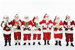 Group of men dressed as Santa Claus holding gifts Stock Photo - Premium Royalty-Free, Artist: Robert Harding Images, Code: 693-06021806