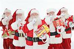 Group of men dressed as Santa Claus holding gifts Stock Photo - Premium Royalty-Free, Artist: Robert Harding Images, Code: 693-06021813