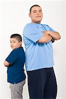 Portrait of teenage (16-17) and pre-teen (10-12) boy Stock Photo - Premium Royalty-Freenull, Code: 693-06021885