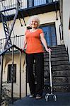Woman with walking cane outside house Stock Photo - Premium Royalty-Freenull, Code: 693-06021930