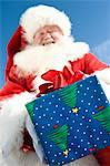 Father Christmas gives a present, low angle view Stock Photo - Premium Royalty-Free, Artist: Water Rights, Code: 693-06022079
