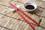 Red chopsticks and side bowl of soy sauce Stock Photo - Premium Royalty-Free, Artist: AWL Images, Code: 693-06022131