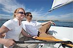 Young couple relax on deck of sailing boat Stock Photo - Premium Royalty-Free, Artist: Aurora Photos, Code: 693-06022157