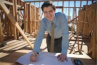 Site manager with building plans Stock Photo - Premium Royalty-Freenull, Code: 693-06022181