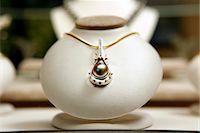 expensive jewelry - Round black pearl with diamonds Stock Photo - Premium Royalty-Freenull, Code: 693-06022199