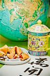 Still life with fortune cookies and globe Stock Photo - Premium Royalty-Free, Artist: Blend Images, Code: 673-06025388
