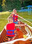 Two young boys paddling canoe Stock Photo - Premium Royalty-Free, Artist: Aurora Photos, Code: 673-06025445