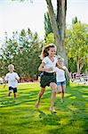 Three young children running in park Stock Photo - Premium Royalty-Free, Artist: Uwe Umstätter, Code: 673-06025463