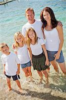 Family of five standing in lake Stock Photo - Premium Royalty-Freenull, Code: 673-06025466