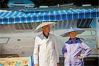 Senior couple in rain hats near airstream camper Stock Photo - Premium Royalty-Freenull, Code: 673-06025484
