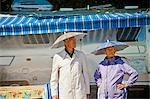 Senior couple in rain hats near airstream camper Stock Photo - Premium Royalty-Freenull, Code: 673-06025484