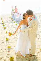Bridal couple kissing on beach Stock Photo - Premium Royalty-Freenull, Code: 673-06025622