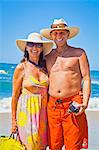 Smiling man and woman arm in arm on beach Stock Photo - Premium Royalty-Free, Artist: GreatStock, Code: 673-06025673