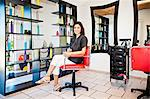 Beautician seated on chair in beauty salon Stock Photo - Premium Royalty-Free, Artist: Blend Images, Code: 673-06025679