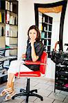 Beautician seated on chair in beauty salon Stock Photo - Premium Royalty-Free, Artist: Ikon Images, Code: 673-06025688