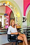 Beautician seated on chair in beauty salon Stock Photo - Premium Royalty-Free, Artist: Ikon Images, Code: 673-06025694