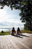 stockholm - Two women sitting on wooden porch Stock Photo - Premium Royalty-Freenull, Code: 6102-06025881