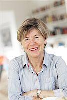 Portrait of smiling mature woman Stock Photo - Premium Royalty-Freenull, Code: 6102-06026128