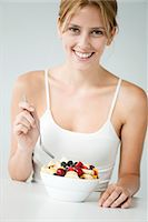 Young woman with fruit bowl Stock Photo - Premium Royalty-Freenull, Code: 632-06029353