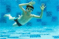 preteen swim - Boy swimming underwater in swimming pool Stock Photo - Premium Royalty-Freenull, Code: 632-06029386