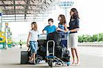 Family standing outside of airport with luggage Stock Photo - Premium Royalty-Free, Artist: Cultura RM, Code: 632-06029401