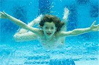 Girl swimming underwater in swimming pool Stock Photo - Premium Royalty-Freenull, Code: 632-06029445