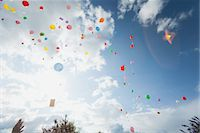 release - Balloons floating toward sky Stock Photo - Premium Royalty-Freenull, Code: 632-06029524