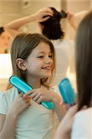 Girl brushing hair Stock Photo - Premium Royalty-Freenull, Code: 632-06029615