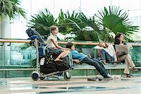 Family waiting in airport terminal Stock Photo - Premium Royalty-Freenull, Code: 632-06029699